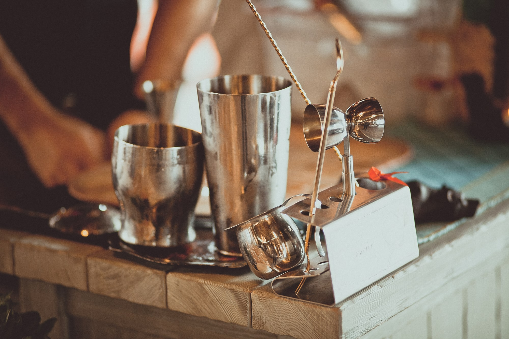 Bartender equipment cocktail shaker and spoons on the bar