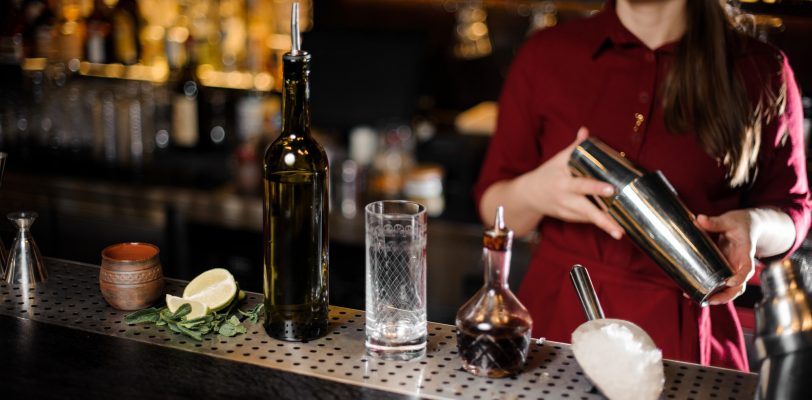 Bar attendant holding professional cocktail shaker