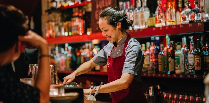Woman bartender teaching mixology classes