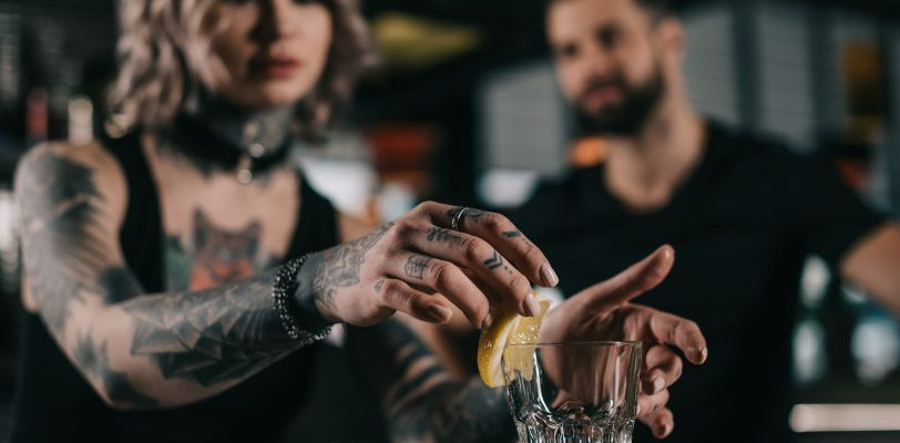 Beginner bartender practising techniques and mixology terms
