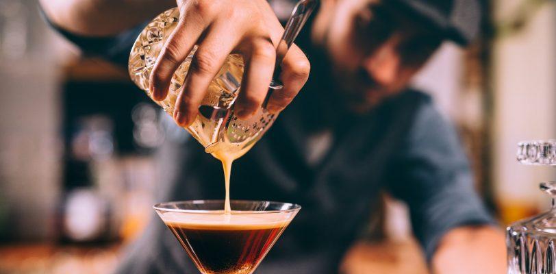 Bartender using Hawthorn drink strainer