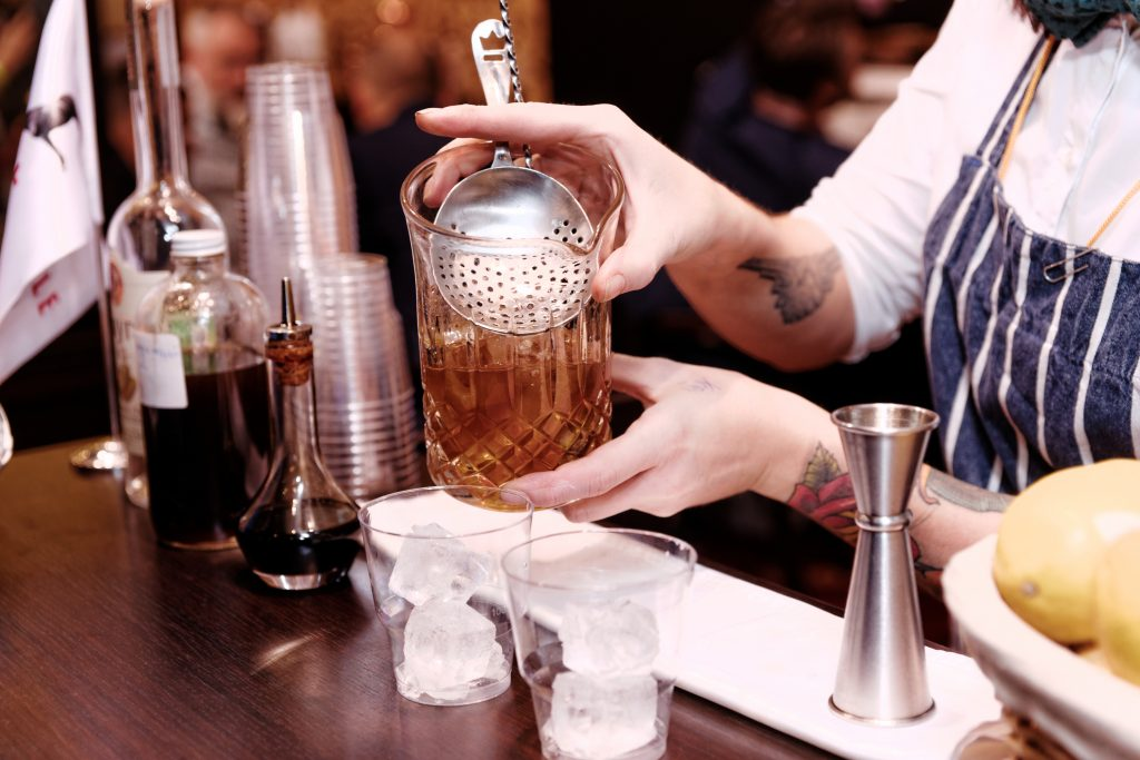 Bartender using a Julep strainer