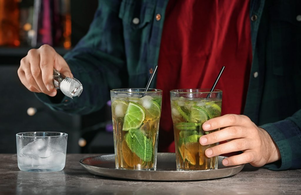 Bartender preparing mint julep cocktail with mixology basics