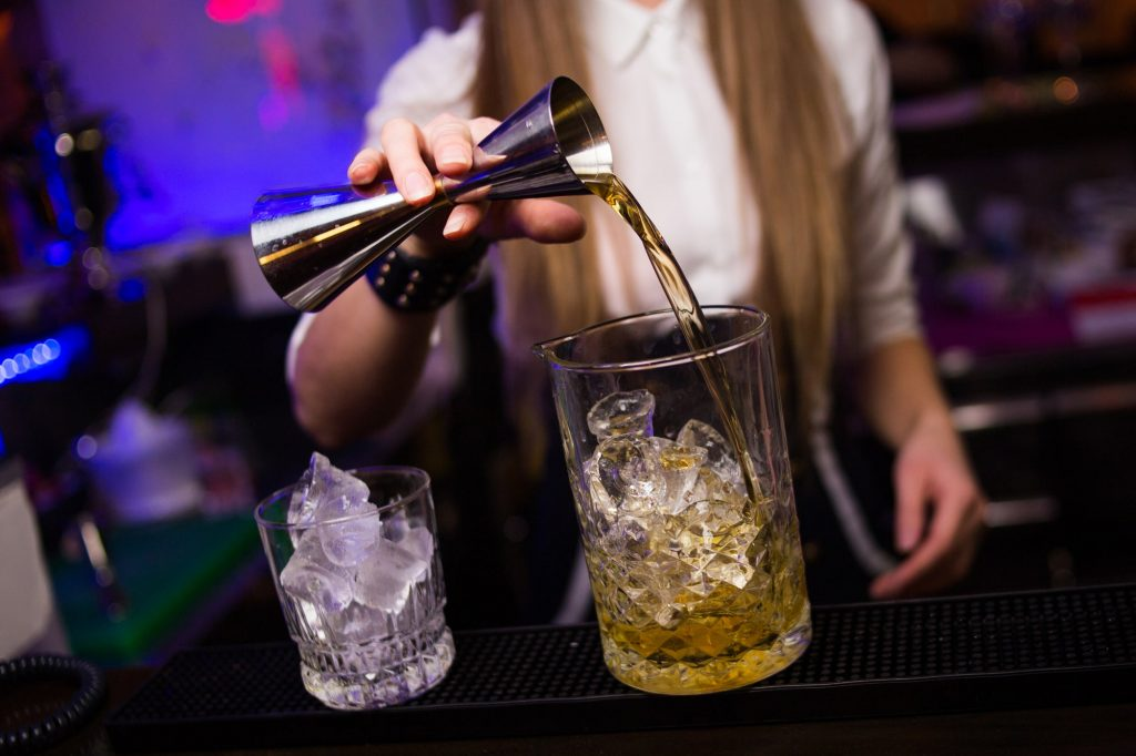 Photo of a bartender pouring a drink