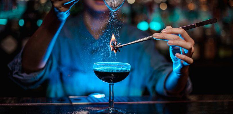 Female Bartender Making a Fun Experimental Cocktail